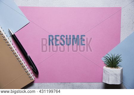 Resume Text On Pink And Blue Background Flat Lay Concept. Suitable To Used As Title Cover Each Subto