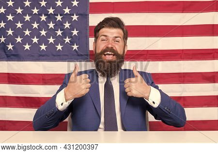 Make Our Land The Absolute Best Country. Happy Hipster Give Thumbs Ups. Usa Flag Background. Bearded