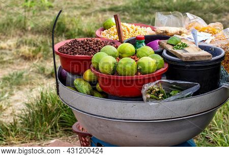 Spicy Peanuts, Peas, And Snacks With Vegetables On A Bowl From A Street Vendor Beside The Road Close