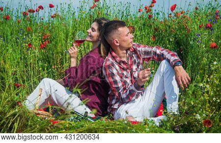 Couple In Love Of Man And Woman Drink Red Wine In Summer Poppy Flower Field, Opium
