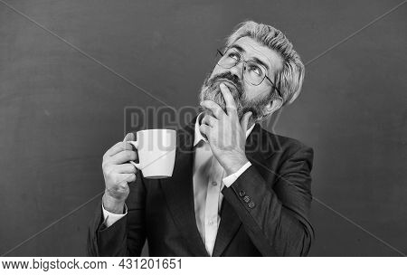 If You Can Dream It, You Can Do It. Elderly Dreamer With Pensive Look. Bearded Man Dream Drinking Te