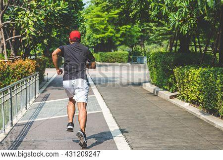 Running Man Tying Shoelaces Wearing Black Shirt