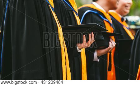Close Up Graduate Holding A Hat. Concept Sucess Education In University With Copy Space.