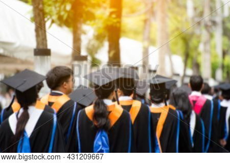 Rear View Of Graduates Join The Graduation Ceremony At The University. Education Graduation In Unive