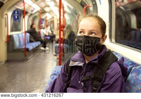 Mal. Young Teenage Girl With Face Covering Mask On The Subway. Mask Against Covid. Teenager With Fac