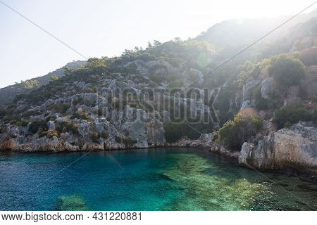Mediterranean Sea Overlooking The Mountains. Aerial Top View Of Sea Waves Hitting Rocks On The Beach