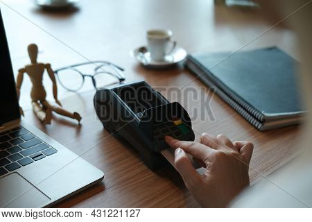 Closed Up With Female Hand Using Credit Card Reader And Laptop Computer.