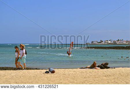 Fuerteventura, Canary Islands, Spain - September 16, 2018 : Tourists On Corralejo Beach In Fuerteven