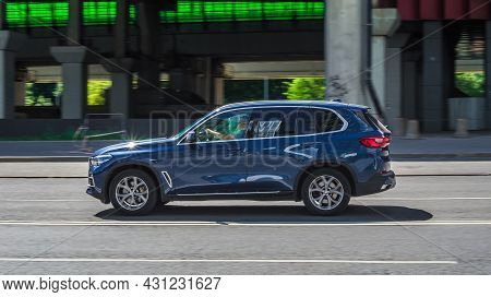 Bmw X5 Suv Vehicle On The City Road. Fast Moving Blue Car On Moscow Streets. Accelerating With Low-e