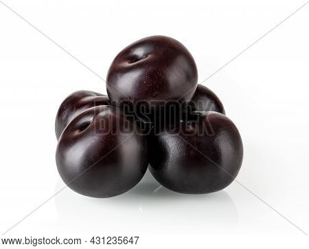 Pyramid Of Ripe Juicy Whole Black Plums Isolated On White Background. Ready To Eat Fresh Ripe Sweet