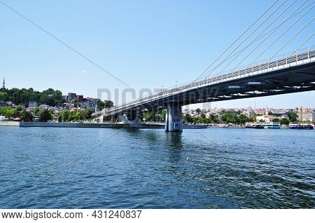 Panorama Of The Sea Strait. View Of The Large Bridge Across The Strait. Coastline With Residential B