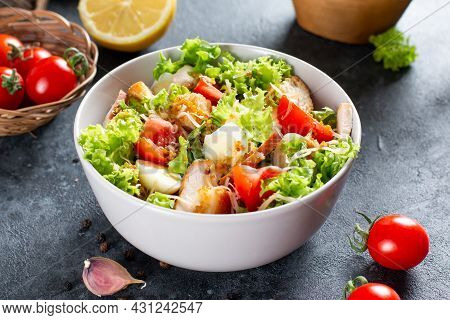 Caesar Salad With Smoked Chicken And Parmesan On A Plate On Dark Background. Copy Space.