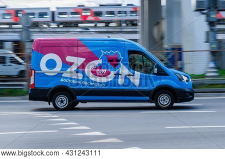 Delivery Van Of The Russian Online Store Ozon In Motion On The Street. Blue Mini Van Truck For Deliv