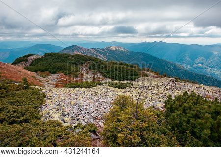 Mountain Landscape In Autumn. Wonderful Nature Scenery On A Cloudy Day. Stones And Plants On The Hil