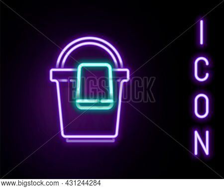 Glowing Neon Line Bucket With Rag Icon Isolated On Black Background. Cleaning Service Concept. Color