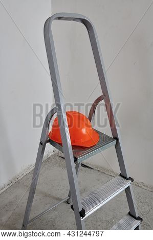 Renovated Apartment With A Stepladder And A Helmet