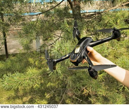 A Woman\'s Hand Launches A Drone Into Flight. With The Help Of A Quadcopter, You Can Take Photos And