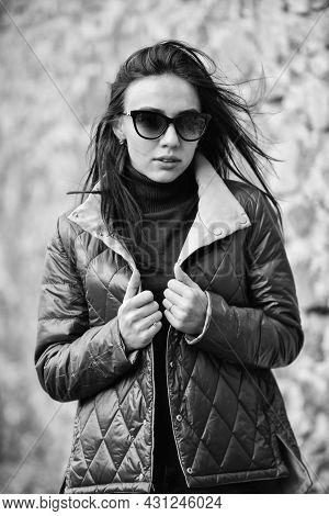 Girl Short Jacket Urban Style. Female Psychology. Woman Fashion Model Outdoors. Woman Enjoy Cool Wea