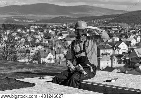 Roofer Constructing Roof. Master Repair Roof. Flat Roof Installation. Man Hard Hat Working Outdoor L