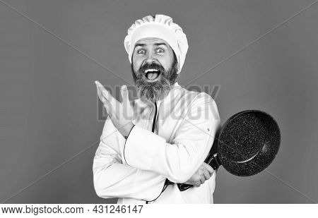 Bearded Cook Uniform Man Hold Cooking Pan. Cooking Like Pro. Easy Cheap Tasty Meals Prepared At Home