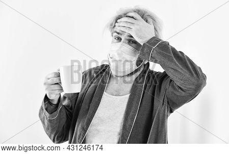 Man Drink Coffee In Respirator Protective Mask. Coronavirus Pandemic Outbreak. Doctor Breathing Resp