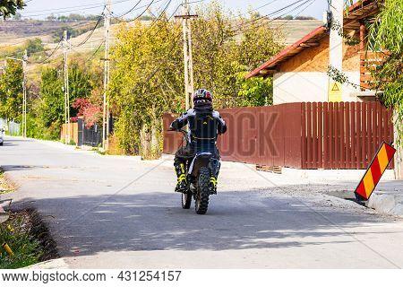 Backview Of Rider On His Enduro Motorbike On A Village Road Near Targoviste, Romania, 2021