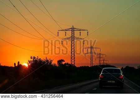 Car Traffic At Rush Hour. Traffic Jam, Cars On The Road At Sunset In Bucharest, Romania, 2021