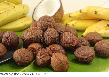 Rice Fritters Made With A Batter Of Rice Flour, Banana, Jaggery And Roasted Coconut Pieces. Made In