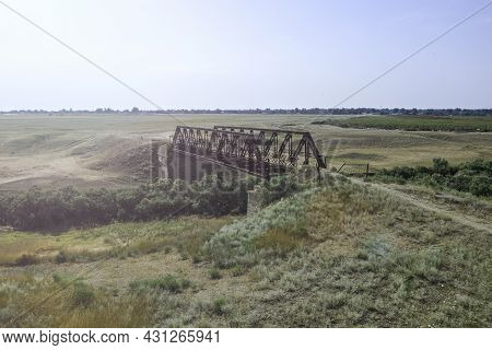 An Old Iron Bridge Over A River In The Steppe On A Country Road Bright Sunlight In The Sky Photo Fro