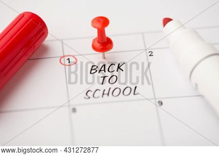 Closeup Photo Of Mark On Calendar At First Inscription Back To School With Red Pushpin And Felt Pen
