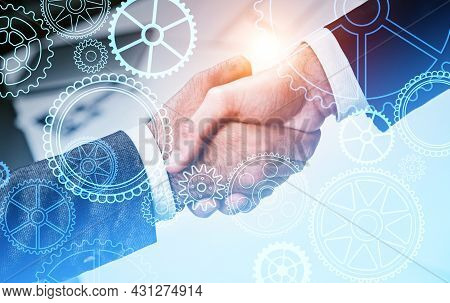 Two Businessman Wearing Formal Suits Are Shaking Hands With Each Other. Blurred Office Workplace In