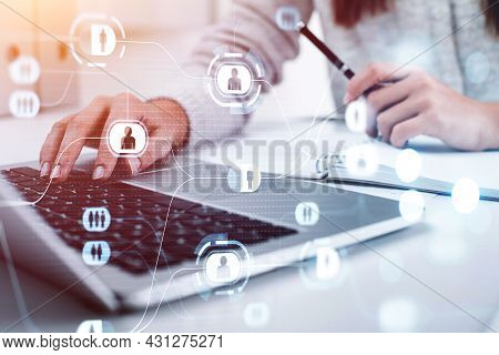 Businesswoman Wearing White Pullover Is Typing Message On Laptop. Office Workplace With Notebook In