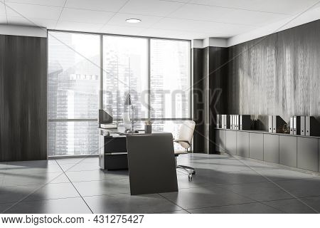 Corner View On Dark Office Interior With Panoramic Window With City Skyscraper, Laptop, Armchair, Wo
