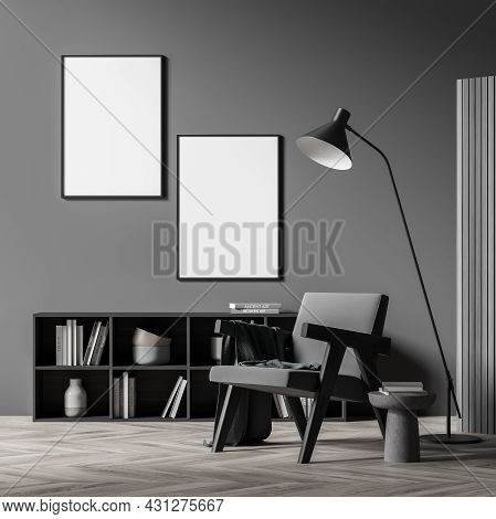 Dark Living Room Interior With Two White Empty Poster, Comfortable Armchair, Coffee Table, Bookshelf