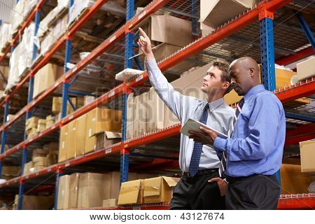 Two Businessmen With Digital Tablet In Warehouse