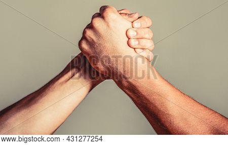 Man Hand. Two Men Arm Wrestling. Arms Wrestling. Closep Up. Friendly Handshake, Friends Greeting, Te