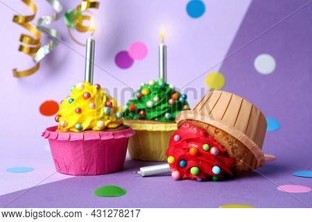 Dropped Cupcake Among Good Ones On Color Background. Troubles Happen