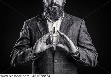 Male Holding Up Bottle Of Perfume. Man Perfume, Fragrance. Perfume Or Cologne Bottle And Perfumery,