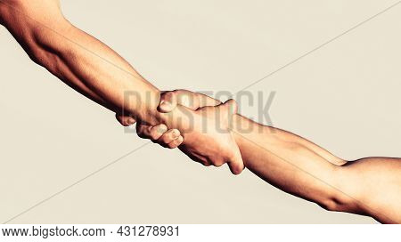 A Friendly Handshake. Two Hands, Shaking Hands. Two Hands, Helping Arm Of A Friend, Teamwork. Rescue