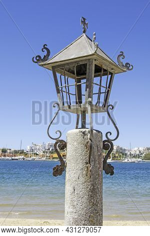 Old Lighthouse Of The Town Of Ferragudo In The Algarve, Portugal