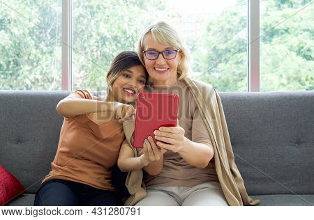 Happy Mix Skin Family Living Together. Asian Daughter Take A Selfie With Her Adopted Caucasian Mothe