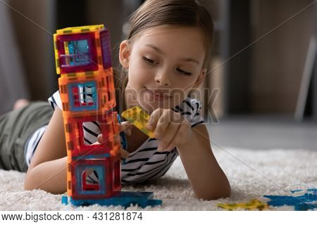Happy Preteen Child Girl Playing Toys, Lying On Carpet.