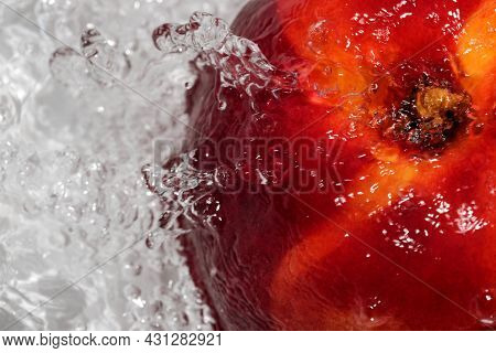Ripe Sweet Nectarine Is Washed Under A Stream Of Clean Water Close-up Macro Photography