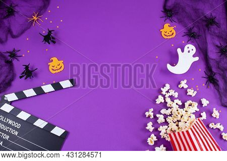 Movie Clapper Board In Spider Webs, Spiders, Ghost, Eyes On Purple Lilac Background.