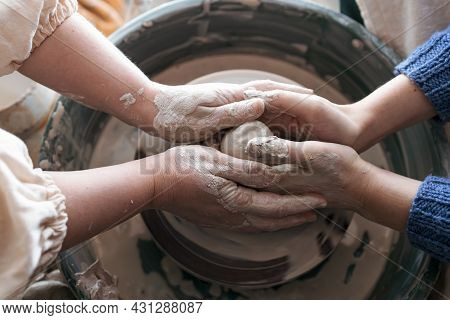 The Hands Of The Trainer Guide The Beginner. Creation Of Trial Clay Products. Pottery Courses For Be