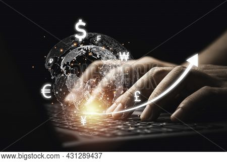 Businessman Using Computer Laptop With Virtual World With Currency Sign Such As Dollar Yen Yuan Euro