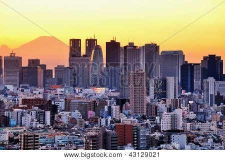 Skyscrapers in the Shinjuku Ward of Tokyo with Mt. Fuji visible.
