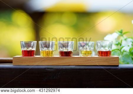 Assortment Of Five Strong Alcoholic Drinks And Spirits In Small Glasses. Different Lithuanian Alcoho
