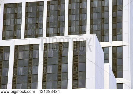 Close Up Detail View Of The Tops Of Tall White Modern Apartment Buildings With White Cladding