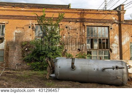 A Dismantled Cistern In An Old Abandoned Factory. Dangerous Place In An Abandoned Chemical Plant